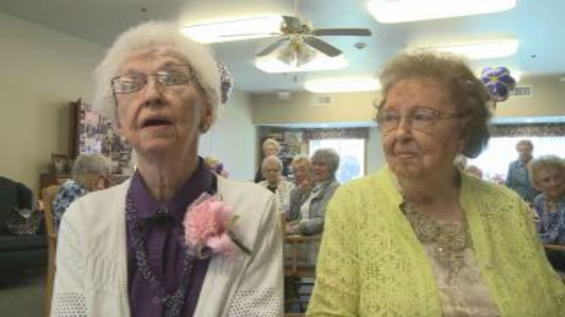 Lorena Becker, 100, sits next to her sister, Laura Jarmusz, 103, as the two celebrate Becker's birthday.