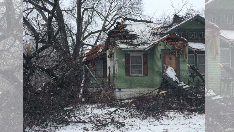 House at 3300 block Country Club Blvd. is damaged by fallen tree branches. Homeowners were not home at the time.