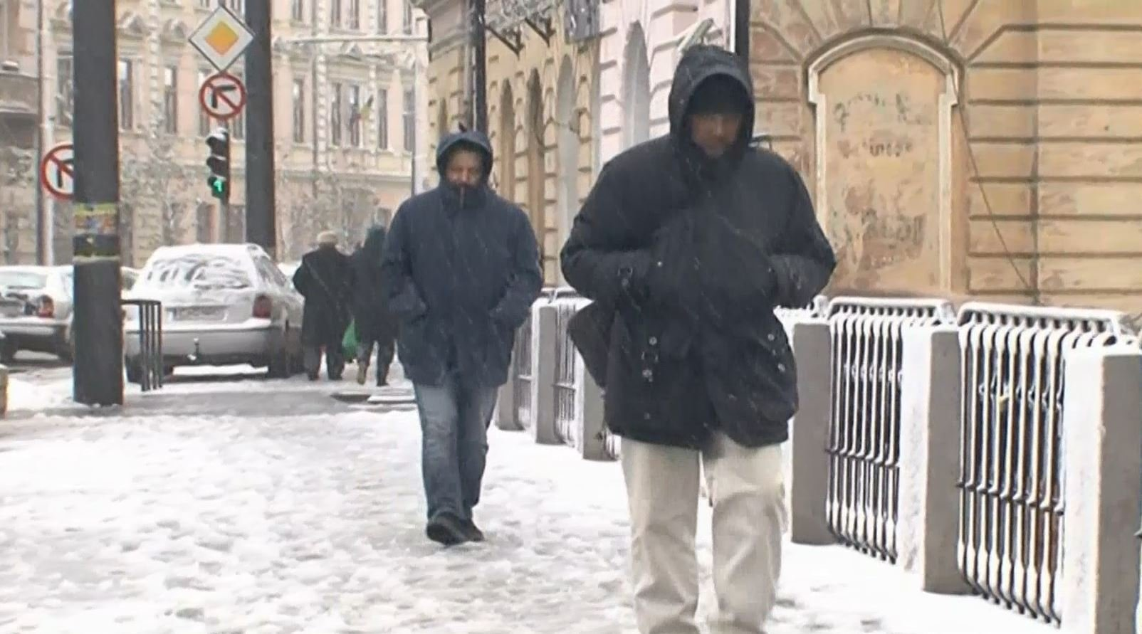 Citizens of Romania bearing snow and cold temps.