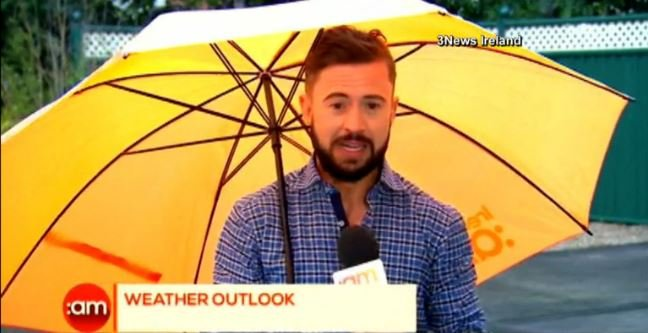 Deric Hartigan giving his report during a newscast in Ireland.