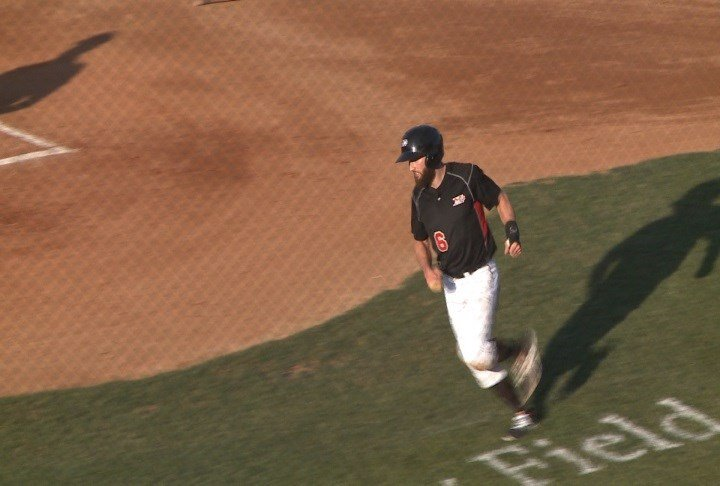 Michael Lang scores a run during Sioux City's loss to Texas on Friday night.