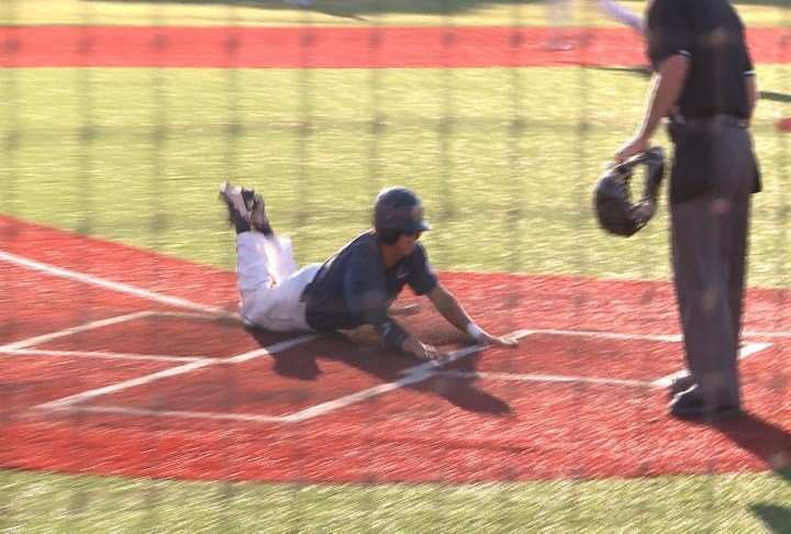 Matt Nelson slides home during Bishop Heelan's 9-3 win over Sgt. Bluff-Luton on Monday.