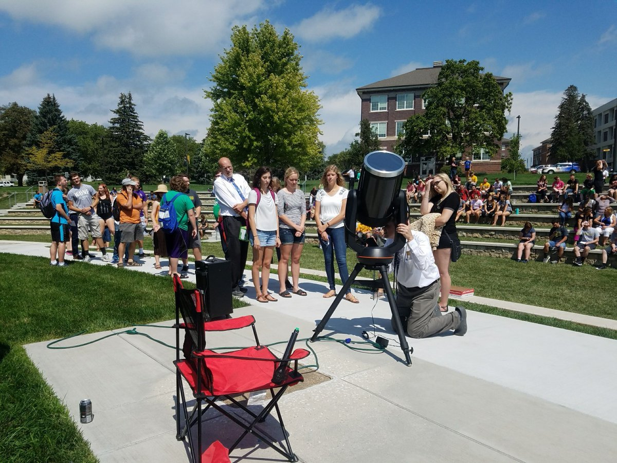 Students are lining up to see the eclipse through the telescope here at Wayne State College.