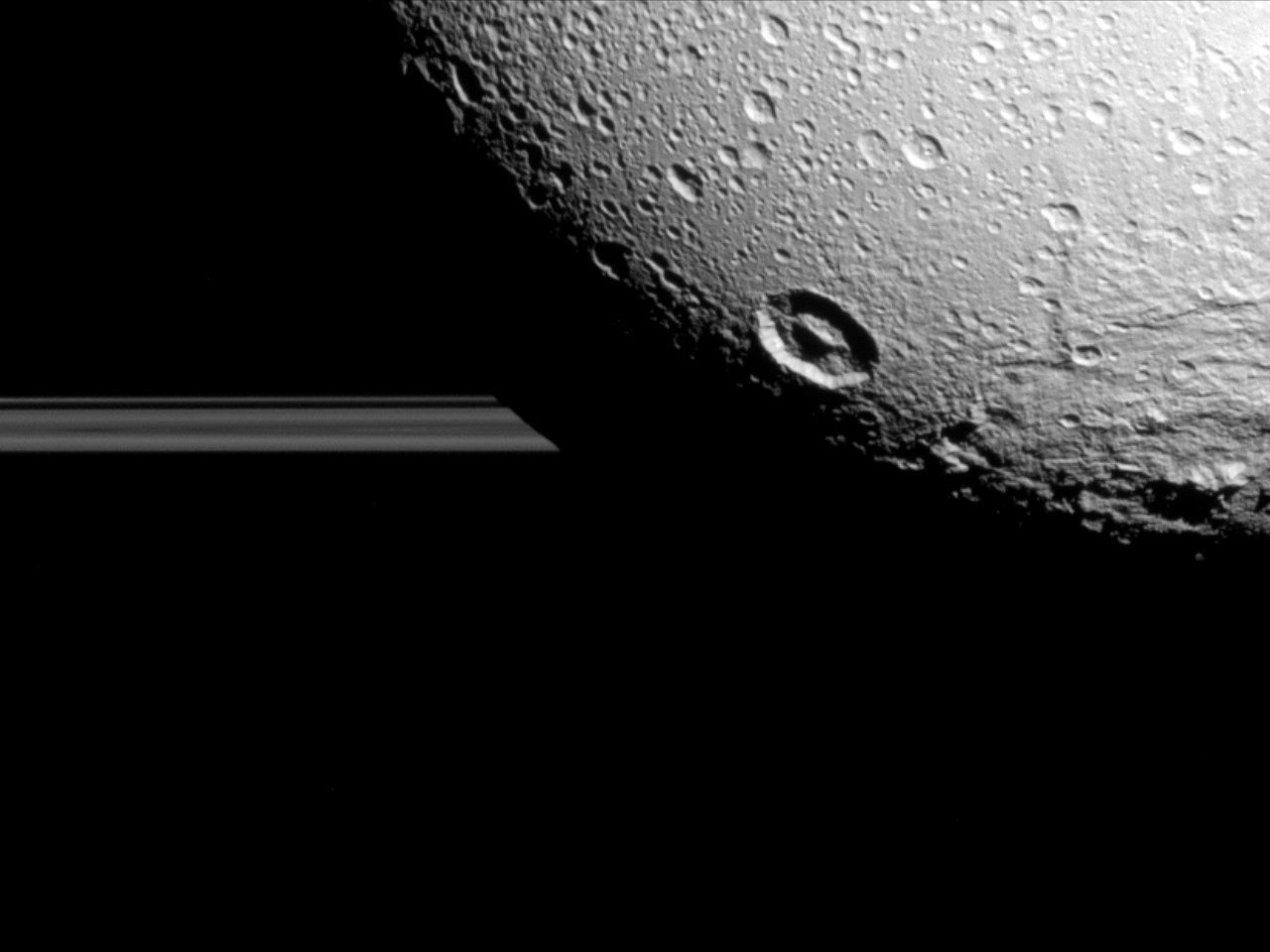 A view of Saturn's rings and it's moon: Dione at a distance of approximately 98 000 miles, Photo Date: August 17, 2015