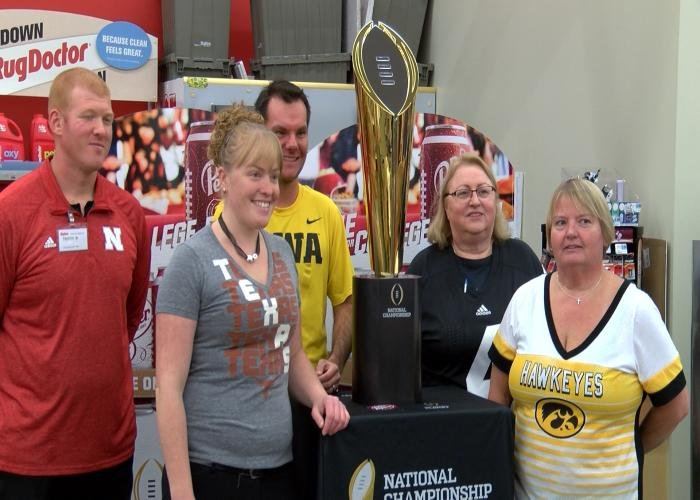 Fans pose with the college football national championship trophy in Sioux City.