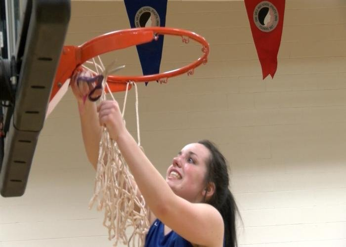 West Sioux cuts down the net after beating IKM-Manning on Wednesday night.