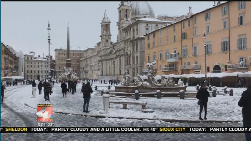 Snowmen and skiers in Rome after historic snowfall