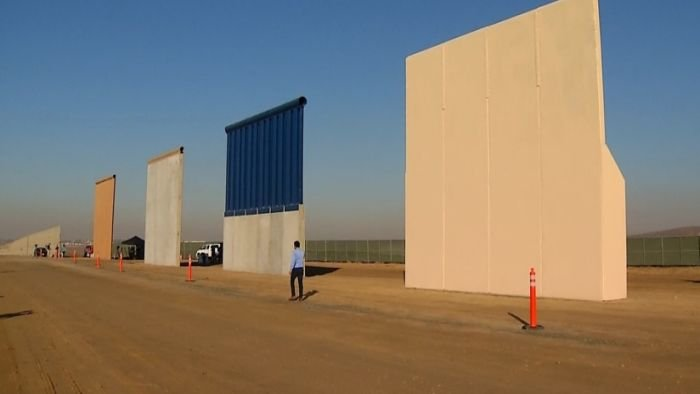 President Trump travels to California Tuesday, where he'll inspect prototype sections of the border wall that was a central focus of his campaign.