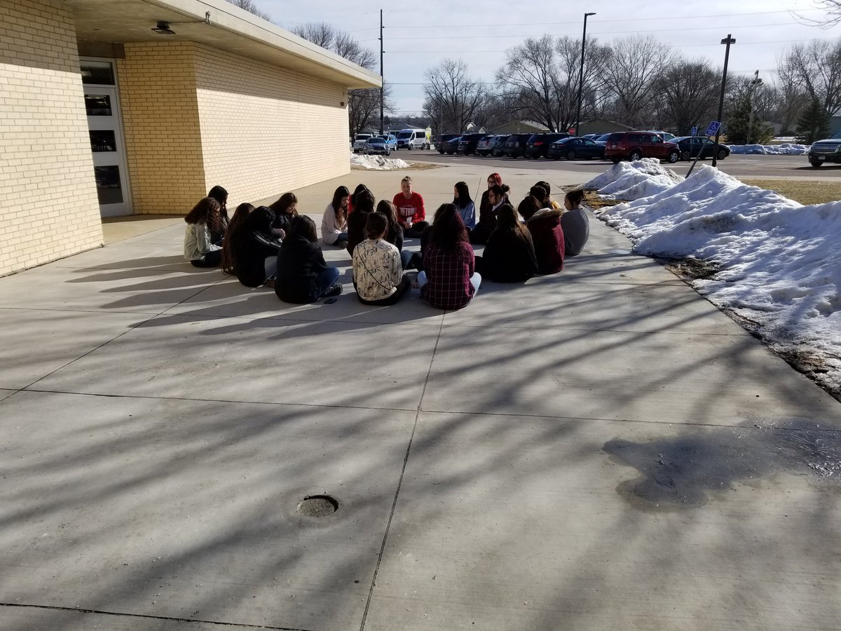 A group of South Sioux City HS students have decided to participate in the actual walk out being seen nationwide. The group is sitting in a circle in complete silence.
