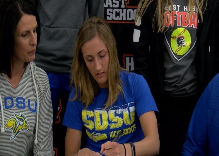 Sioux City East's Lauren Van Dyke signs her letter of intent with South Dakota State on Wednesday.