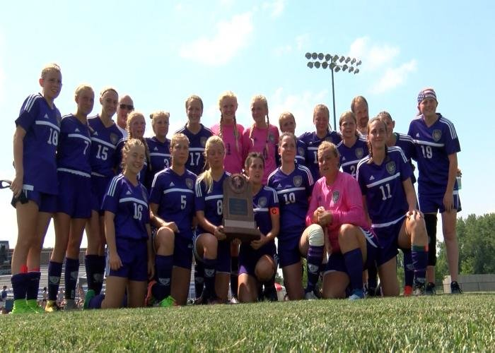 Spencer poses with their trophy at the girls state soccer tournament on Friday.