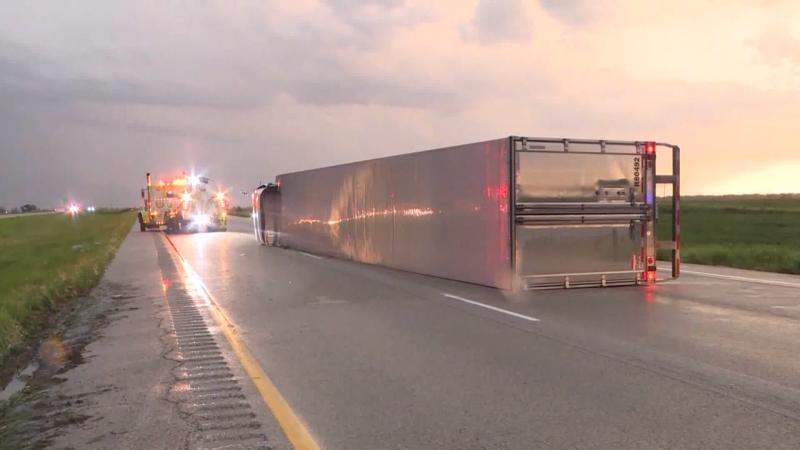 Thunderstorms that blasted through eastern Nebraska into Iowa overturned nine semitrailers on Interstate 29