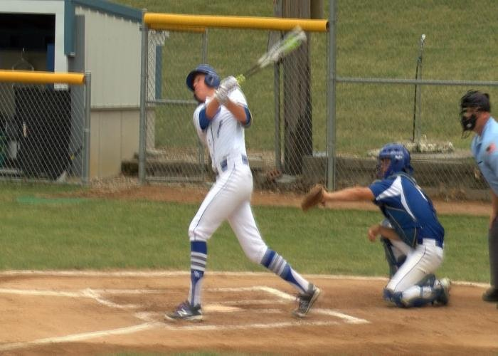 Derrick Schorg hits a home run in Remsen St. Mary's win over Harris-Lake Park on Monday.