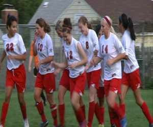 The North girls soccer team celebrates after a goal in Friday's 6-1 win over Sgt. Bluff-Luton.