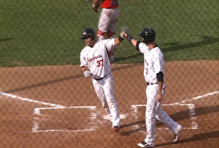 Ray Serrano celebrates with Kris Sanchez following his 2-run home run in the first.