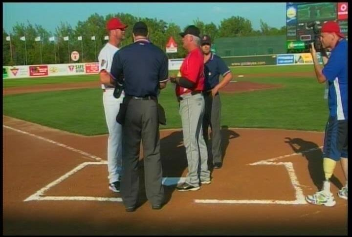 X's manager Stan Cliburn (right) exchanges lineup cards before Tuesday's game in Winnipeg.
