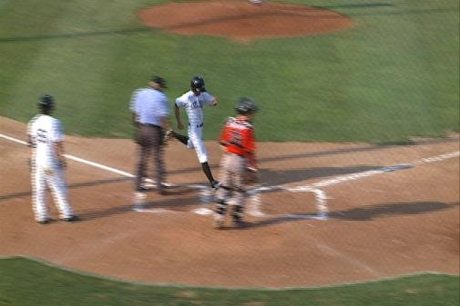 Brian Bistagne scores Sioux City's first run of the game Sunday.