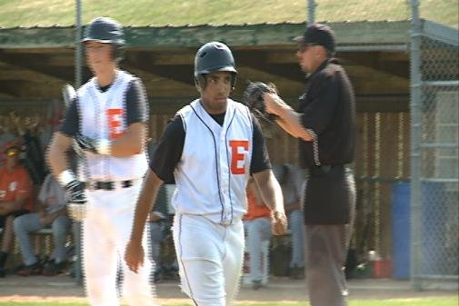 Zach Brown scores a run in East's 10-0 win over Council Bluffs T.J. on Tuesday.