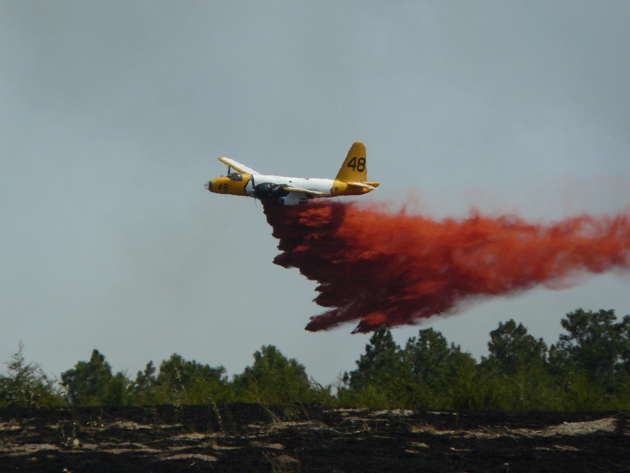 Airplane drops retardant east of Cherry County line. Crews were working to stop the fire from spreading west. Courtesy: Judd Schmop, Clearfield, SD.