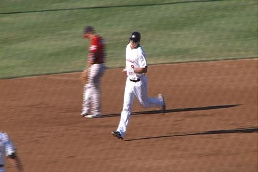 Wally Backman Jr. rounds the bases following his first HR of the season.