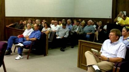 File: More than 100 people packed a meeting of the Madison County Joint Planning Commission opposing a conditional use permit application filed by Helena Chemical Company in June.