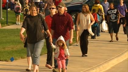 Parents walk their kids to class on first day at new Spaulding School.