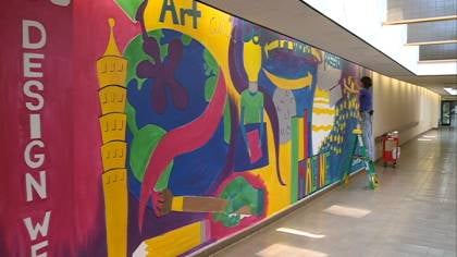 © Irene Lopez paints a mural in the Sioux City skywalk