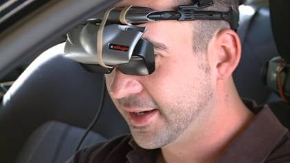 Storn Olson shows off UNITE's virtual reality goggles.