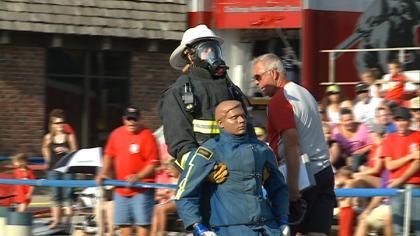 Firefighters take part in the Scott Firefighter Combat Challenge in Hawarden, Iowa.