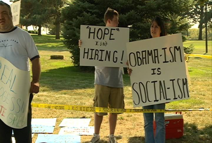 Protestors set up outside President Obama's speech event.
