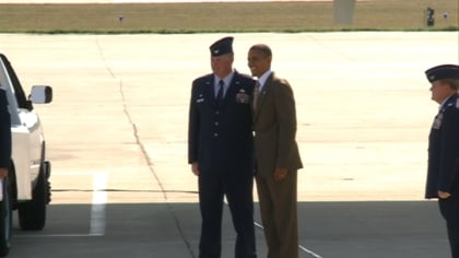 President Barack Obama gives 185th Vice-Wing Commander, Mark Foreman, a coin.