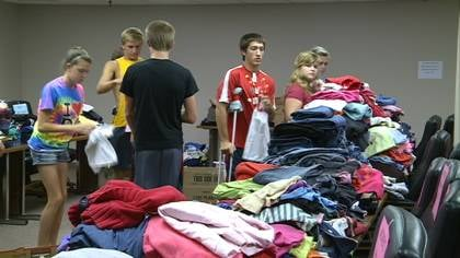 Mayor's Youth Commission sorts clothes before taking them to schools for students in need.