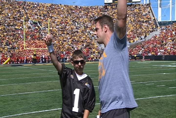 Chaz Renken and Matt Roth fire up the crowd at Kinnick Stadium on Saturday.