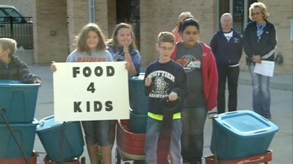 Local church and community members launching a snack bag program, to stop kids from going hungry.