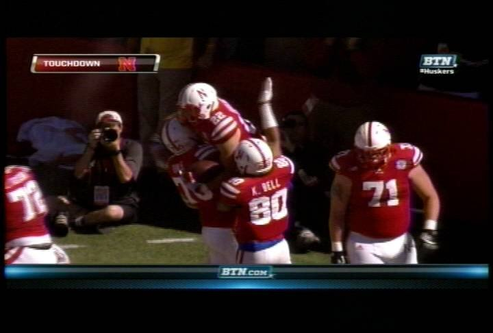 Rex Burkhead celebrates his 61-yard TD with teammates.