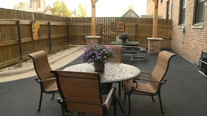 The courtyard has been furnished with a water fountain, comfortable chairs, and flowers
