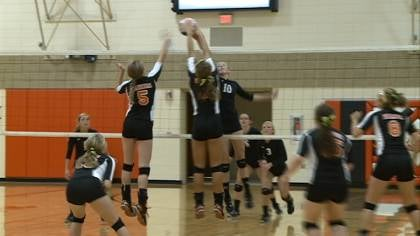 DV's Lindsey Smith wins a battle for a ball at the net.