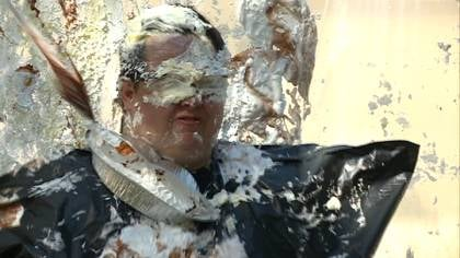 © Briar Cliff University faculty members take a pie in the face for charity.