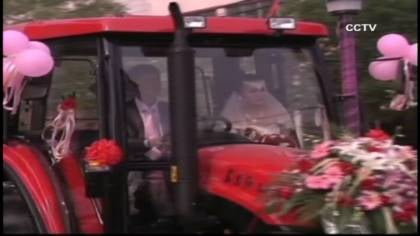 Eight red tractors were decorated with balloons and flowers and paraded through the streets of Kiaogan City.
