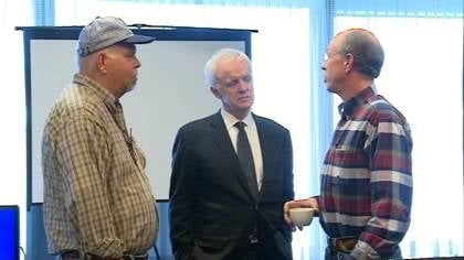 Bob Kerrey talks with supporters at a stop in South Sioux City, Nebraska.