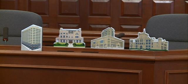 The first four designs include the historic buildings in Sioux City.