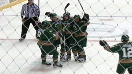 The Musketeers celebrate after a goal by Dan Molenaar in Sioux Falls on Friday night.