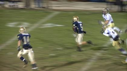 Jack Wegher runs for a touchdown in Bishop Heelan's 57-35 win over Spencer on Monday.