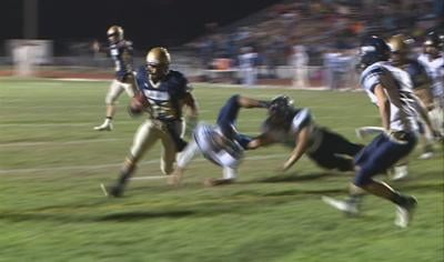 Manny Alcarez scores a touchdown in Bishop Heelan's 21-0 win over Lewis Central.