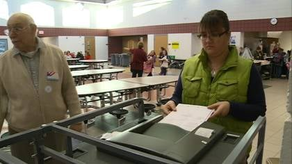 A voter casts her ballot at Leeds Elementary School in Sioux City Tuesday morning