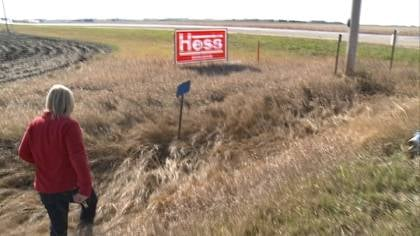Megan Hess removes political signs a day after being elected to a seat in the Iowa Legislature.
