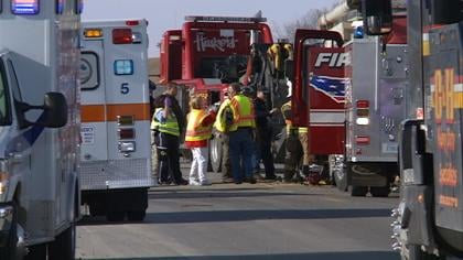 Emergency responders work to free a man trapped inside a truck after a crash near Jackson, Nebraska.