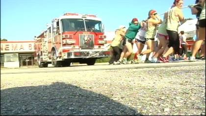 Teams of 10 competed to see who could pull a fire truck 80 yards in the fastest time.