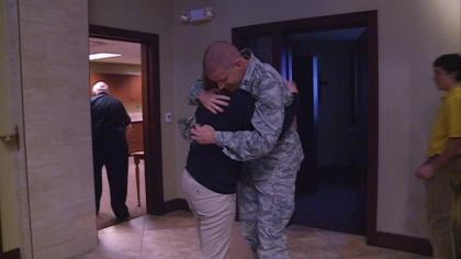 Capt. Andy Sohm hugs his sister after making surprise visit at St. Joseph's in Le Mars, IA