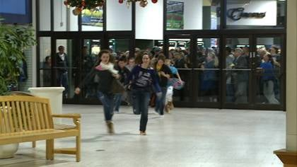 Crowds rushed through the doors of the Southern Hills Mall at 11 p.m.